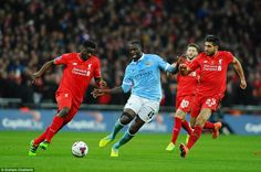 Kolo Toure (left) dispossess his brother Yaya as the two siblings go head-to-head during the Capitol One cup final at Wembley