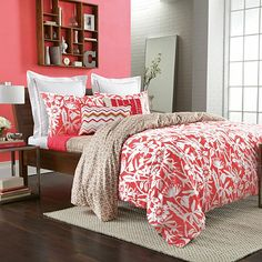Add beautiful color and style to your bedroom with the Chely duvet cover set. This bedding features a bright modern floral in dark coral that reverses to a natural geometric print for an eye-catching combination of patterns and decorating versatility.