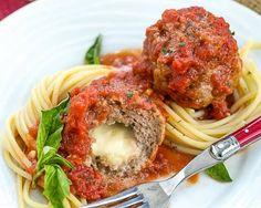These Mozzarella Stuffed Meatballs are tender, flavorful and filled with gooey cheese! You'll savor every bite. Mozzarella Stuffed Meatballs When Nick was in high school, I schlepped along a stack of recipes to one of his basketball Gluten Free Recipes Beef, Fodmap Recipes, Beef Recipes, Cooking Recipes, Italian Dishes, Italian Recipes, Mozzarella Stuffed Meatballs, Good Food, Yummy Food