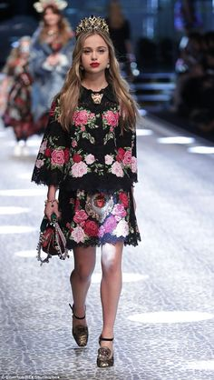 The young royal aptly wore a crown on the Dolce & Gabbana runway in Milan yesterday