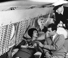 These passengers, pictured in 1958, were chilling out in the sleeper seats of a new Comet 4 plane during a demonstration flight at Hatfield airport.