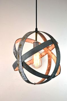 Industrial pendant light made from wine barrel rings...this is awfully hip, but I love the atomic age look.