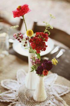 simple floral centerpieces in milk glass arrangements