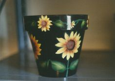 Hand-painted flower pot by Sandy Hurst