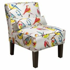 """Bird-printed accent chair with pine wood framing and a coordinating pillow. Handmade in the USA.     Product: ChairConstruction Material: Solid pine wood, polyurethane foam padding and fabric Color: MultiFeatures:  Handmade in the USAPillow includedWill enhance any setting Dimensions: 33"""" H x 25"""" W x 32"""" D"""