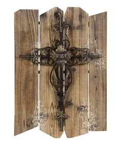 Create a warm and cozy home with this charming rustic touch. As an exquisite centerpiece or an accent, this elegant cross effortlessly enhances décor.