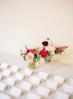 escort card display - photo by Michelle March http://ruffledblog.com/fuchsia-and-emerald-wedding-at-villa-woodbine