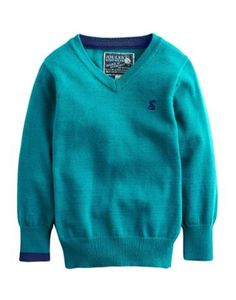 Joules Boys V Neck Jumper, Dark Topaz.                     Just like Dad's only smaller. This fine gauge knit will have your little whippersnapper looking smart and feeling cosy throughout the autumn and winter months. We recommend pulling it on over a shirt or t-shirt. The contrast cuff provides the unexpected detail.