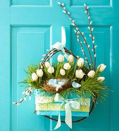 White pussy willow buds and dainty white tulips make a lovely spring door decoration along with a cute nest. More spring door decor: http://www.midwestliving.com/homes/seasonal-decorating/spring/wreaths/