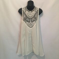 "☀️Summer Sale! Lace Semi-Sheer Sundress/Tunic Top Gorgeous dress! It is semi sheer so you will need to layer. You can wear as a dress or as a tunic. Please read the measurements before purchasing. The medium and small come in the all cream and the large is a separate listing with a white/cream combo. Medium: bust- 18"" length- 32""; Small: bust- 17"" length- 32"". Dresses"