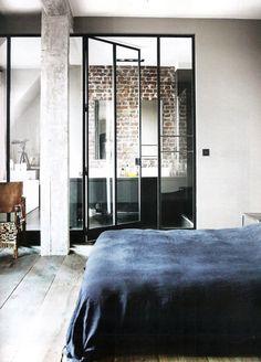 black metal window frames as dividing walls