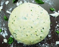 Parmesan and Basil Pizza Dough - Parmesan and basil kneaded into the dough creates a crust with a delicious crispy salty bite