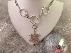 A personal favorite from my Etsy shop https://www.etsy.com/listing/250676618/snowflake-pedant-necklace-on-silver-tone