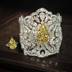A very rare GRAFF Yellow & White diamond Cuff and a Fancy Intense Yellow pear shape ring totaling 68.41 carats