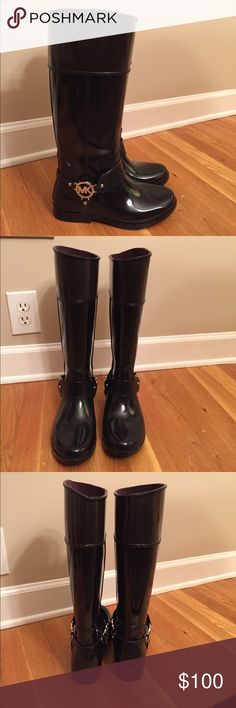 Micheal Kors Tall Rain Boots Size 7 NEW! So stylish and they are super cute! These have the silver MK emblem on both sides and are black and the top is brown so will look good with everything! I also have the Michael Kors boot socks in a separate listing! Bundle and save! Michael Kors Shoes Winter & Rain Boots