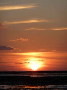 c'est un coucher de soleil que j'avait  appercu une nuit d'été lors de mes balades près des plages