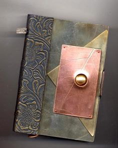 Amazing metal work by Lorna Lawson.  This site has lots of wonderful covers by many artists