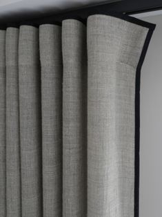 ripple fold curtains with contrast braid to top and leading edge