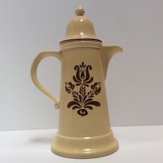 A personal favorite from my Etsy shop https://www.etsy.com/listing/449222514/pfaltzgraff-coffee-pot-village-13-7-cup