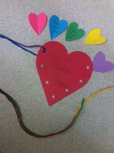 Joseph forgave his brothers necklace. Child 'sews' two hearts together. Ask child what to write on the small hearts (or they can write/draw on them). Place small hearts in large one. Tie a knot in the end of the strings.