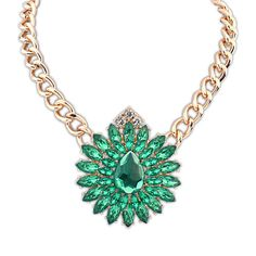 Zara Classic Curb Chain Necklace £12.00  This quirky floral design necklace is perfect for jazzing a work outfit up and any other outfit for that matter. Green is a colour that can be matched with almost any other colour and still look flawless. On top of the green stones in a flower pattern, is three separate stones in a triangular shape, simple yet beautiful.
