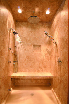 Seriously my dream shower!! double shower heads, a rainfall shower head and heated floors? I would never want to leave.
