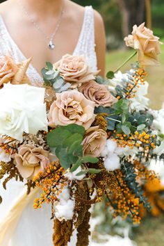 A rambling boho wedding bouquet of antique coloured roses, burnt orange berries, trailing amaranthus and cloud-like cotton Fall Wedding Boquets, Gold Wedding Bouquets, Sage Wedding, Winter Wedding Flowers, Bride Bouquets, Bridesmaid Bouquet, Floral Wedding, Wedding Colors, Rustic Wedding