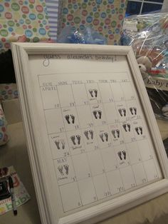Baby shower idea..  Guess the baby's birthday!  Great way to replace a guest book.  We did this with cut out stickers of a pacifier, rattle, and a cupcake.  Each person placed the sticker on the date they predicted and signed their name.  Cute idea.  Mom-to-be loved it.  Cute to put in a scrapbook too!