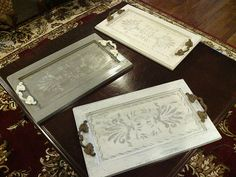I made these trays from old cabinet doors. Visit me on facebook at:  http://www.facebook.com/pages/Faux-Creations/120549561335790
