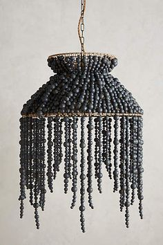 DIY inspiration: Hand-Beaded  Chandelier.                         Gloucestershire Resource Centre http://www.grcltd.org/home-resource-centre/ Wood Bead Chandelier, Chandeliers, Alex Karras, Victor Victoria, Beer Caps, Julie Andrews, Home Lighting, Lighting Design, Lighting Ideas
