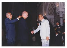 Agence Photographique de Presse Marocaine. Photo Maradji. [Donald S. Fredrickson being decorated by the King of Morocco]. Photographic Print. 1 Image. 1995.