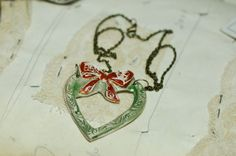 ceramic heart and bow  Necklace by LauraJaineWalker on Etsy, $30.00
