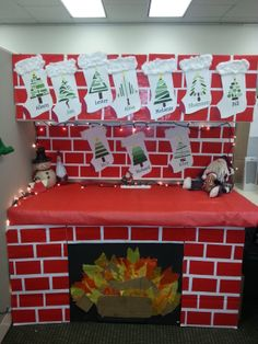 my christmas cubicle decorations the stockings are made from paint chips the fireplace is