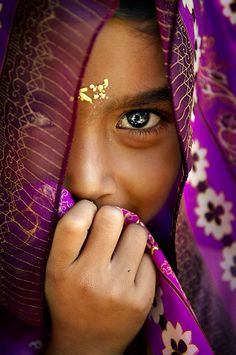 Young Balinese girl with beautiful, striking eyes - Bali Indonesia