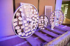 Old bicycle wheels holding place cards--- Luke & Laura - whitesand