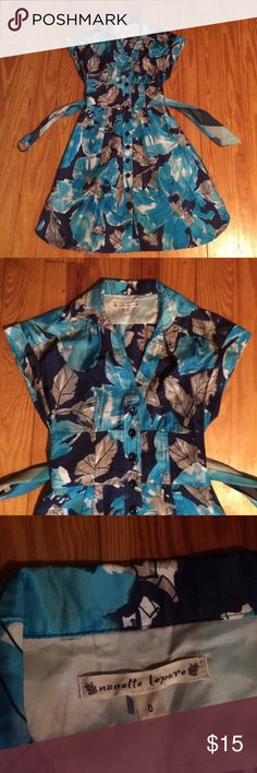 Nanette Lepore spring dress So pretty! It's lined and is a satin-y sort of material. Comes with belt. Has a gorgeous classic (vintage) fit. Nanette Lepore Dresses Midi