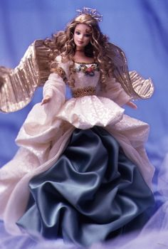 """I originally wanted this Angel of Joy™ Barbie® Doll back in 1998 because she reminded me so much of my late half-sister, who had died just three years prior. I still think there's a soft resemblance, and this is a beautiful but unique take on a common """"angelic"""" theme. She retailed for $49.98, and was part of the """"Timeless Sentiments"""" collection."""
