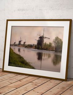 """Mills at Kinderdijk 2 by Tim Abeln Photography and Digital Art Prints. Beautiful wall decoration for your home and office. The name Kinderdijk is Dutch for """"Children dike"""". During the Saint Elizabeth flood of 1421, the """"Grote Hollandse Waard"""" flooded, but the Alblasserwaard polder stayed dry. It is said that... #wallart #interiordesign #windmills #kinderdijk #walldecoration #art"""