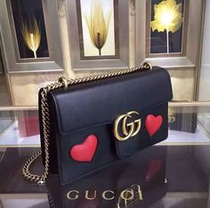Gucci GG Marmont Leather Shoulder Bag  The medium GG Marmont chain shoulder bag has a structured shape and oversized flap closure completed with our Double G hardware. The sliding chain strap can be worn multiple ways, changing between a shoulder and a to