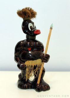 VINTAGE BLACK AMERICANA BLACKFACE GLAZED CERAMIC TRIBAL WARRIOR FIGURINE WITH GRASS SKIRT, SPEAR WITH METAL TIP, HAIR, METAL WIRE HAIR BAND + NECKLACE / NECK RINGS - I'VE NEVER SEEN ANOTHER ONE LIKE IT - PERSONAL COLLECTION www.XOatom.com Neck Rings, Tribal Warrior, Grass Skirt, Mid Century Decor, Glazed Ceramic, Mid Century Modern Furniture, Light Decorations, Vintage Decor, Hair Band