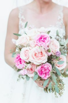 Peach and bright pink bouquet: http://www.stylemepretty.com/2013/08/14/minnesota-winter-wedding-from-paper-antler-photography/ | Photography: Paper Antler - http://paperantler.com/