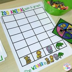 Zoo Animal Spin and Graph for preschool, pre-k, or kindergarten to explore math concepts more, less, and equal to.