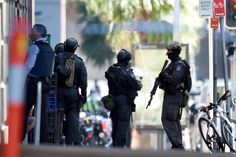 Members of the New South Wales (NSW) Police Force Public Order and Riot Squad (PORS) are seen outside a Lindt cafe in Martin Place in the central business district of Sydney Police Post, Police Gear, Sydney Cafe, 13 In, Central Business District, Ex Wives, Sydney Australia, Special Forces, Vatican