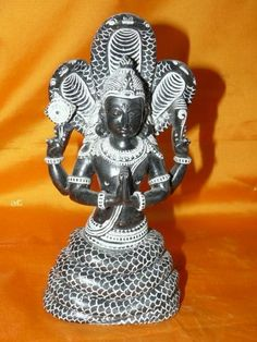 Patanjali the Founder of Yoga System Handcarved black Stone Sculpture 8 Inch by Mogul Interior, http://www.amazon.com/dp/B00582EKII/ref=cm_sw_r_pi_dp_EpkSpb0FN7Z2W