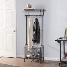 Renfro Metal Entryway Storage Rack - Southern Enterprises storage stands alone with this industrial entryway rack. Removable basket totes a pair of messy boots from the mudroom while ball-tipped hooks carry coats, keys, and leashes. Tv In Bedroom, Bedroom Dressers, Trendy Bedroom, Floating Shelves Bedroom, Floating Shelves Kitchen, Metal Storage Racks, Storage Shelves, Coat Storage Small Space, Shelf Display