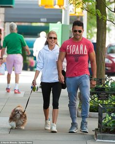 Family day out: In another shot, the TV personality was seen walking alongside her husband, Spanish-born actor Mark Consuelos