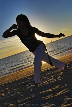 """Capoeira is an Afro-Brazilian art form that encompasses: a fighting style, self-defense, sport, dance, social struggle, folklore, history and culture. We captured Nailah in a silhouette, rhythmically swaying (""""ginga"""") just before the sun went down."""