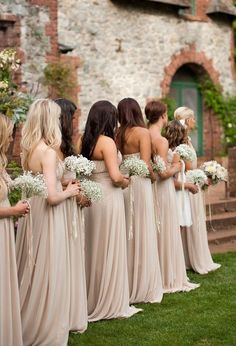 neutral bridesmaid dresses with baby's breath flowers.