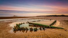 Boat Wreck by AndrzejAntczak beach boat wreck clouds nikon sand sea seascape sky sunset water Boat Wreck AndrzejAntczak Cool Landscapes, Landscape Photos, Vineyard, Places To Visit, Clouds, Sky, Sunset, Water, Facebook