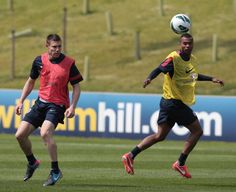 England's James Milner (L) and Ashley Cole vie for the ball during a team training session at the Saint George's Park National Football Centre in Staffordshire, England on May 27, 2013.  England are set to play the Republic of Ireland in an International friendly match at Wembley stadium in London on May 29, 2013